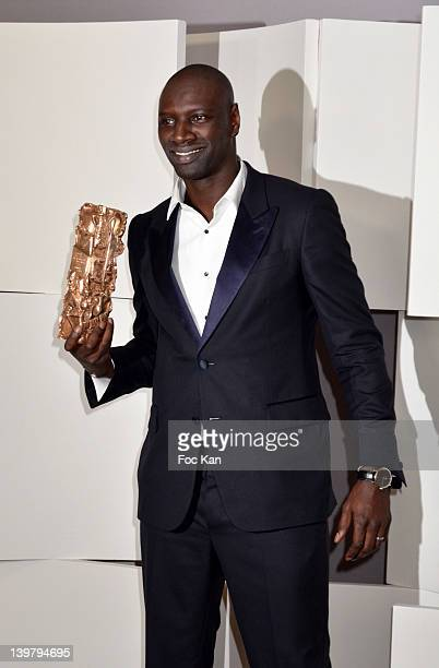 Omar Sy poses after receiving the Cesar Award for Best Actor during the 37th Cesar Film Awards at Theatre du Chatelet on February 24 2012 in Paris...