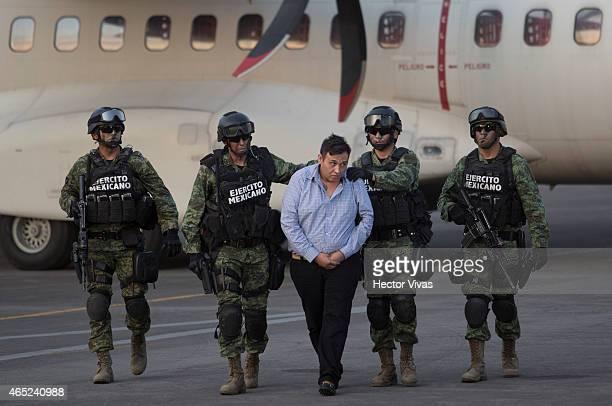 Omar Trevino alias 'El Z42' leader of criminal organisation 'Los Zetas' is escorted by Mexican Army after his arrest in the Mexican State of Nuevo...