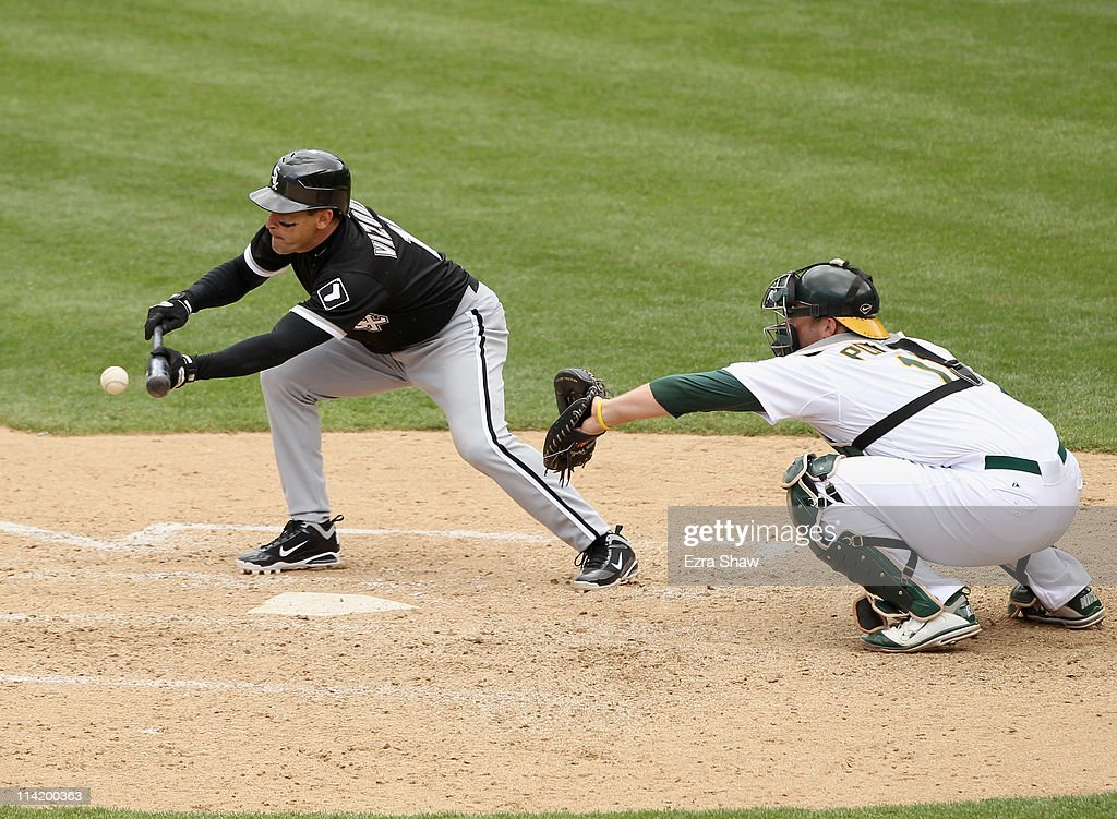 <a gi-track='captionPersonalityLinkClicked' href=/galleries/search?phrase=Omar+Vizquel&family=editorial&specificpeople=201489 ng-click='$event.stopPropagation()'>Omar Vizquel</a> #11 of the Chicago White Sox bunts and reaches first base safely on a throwing error by pitcher Trevor Cahill #53 of the Oakland Athletics at Oakland-Alameda County Coliseum on May 15, 2011 in Oakland, California. Alex Rios #51 of the Chicago White Sox scored on the play.