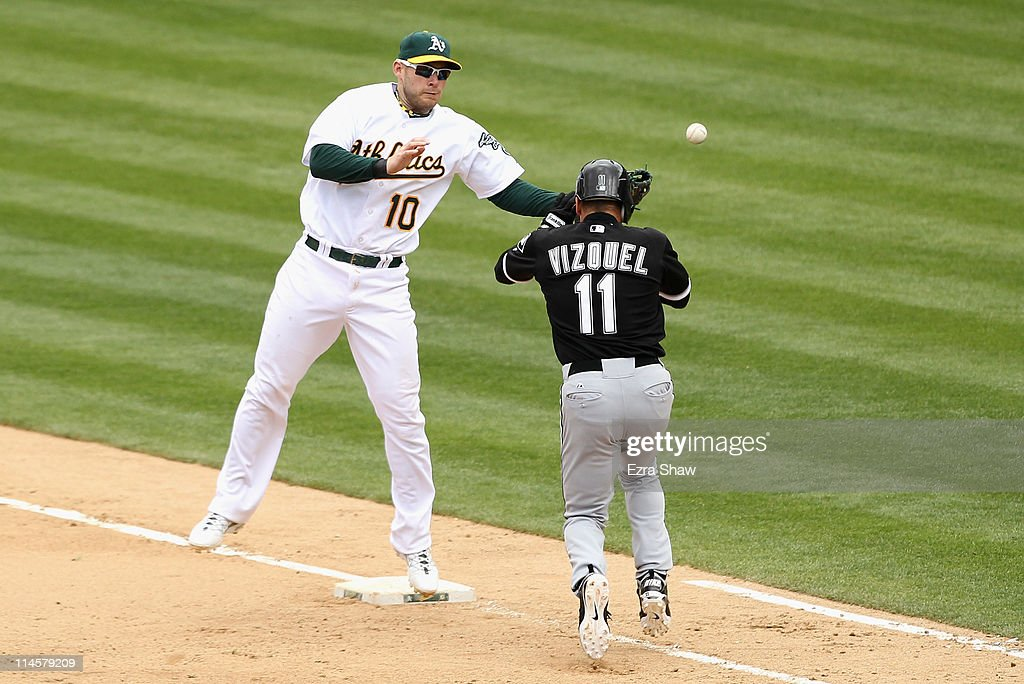 <a gi-track='captionPersonalityLinkClicked' href=/galleries/search?phrase=Omar+Vizquel&family=editorial&specificpeople=201489 ng-click='$event.stopPropagation()'>Omar Vizquel</a> #11 of the Chicago White Sox reaches first base safely on a throwing error by pitcher Trevor Cahill #53 of the Oakland Athletics to first baseman <a gi-track='captionPersonalityLinkClicked' href=/galleries/search?phrase=Daric+Barton&family=editorial&specificpeople=682626 ng-click='$event.stopPropagation()'>Daric Barton</a> #10 of the Oakland Athletics at Oakland-Alameda County Coliseum on May 15, 2011 in Oakland, California. Alex Rios #51 of the Chicago White Sox scored on the play.