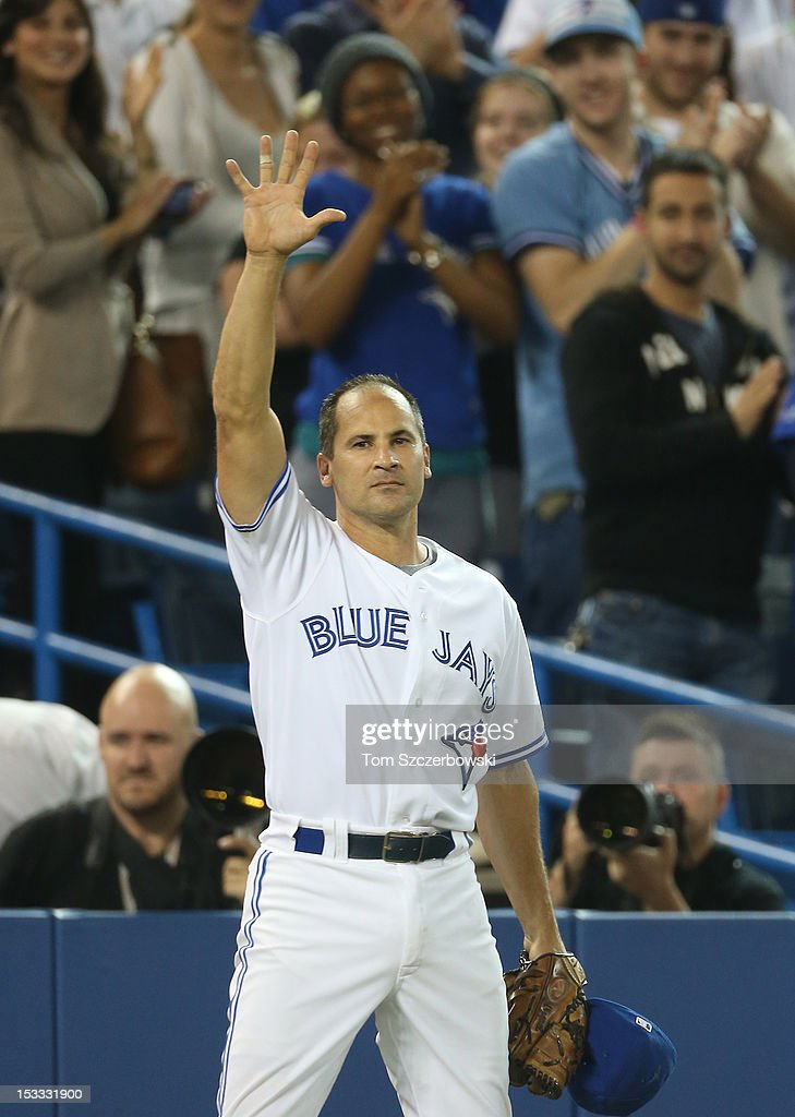 <a gi-track='captionPersonalityLinkClicked' href=/galleries/search?phrase=Omar+Vizquel&family=editorial&specificpeople=201489 ng-click='$event.stopPropagation()'>Omar Vizquel</a> #13 of the Toronto Blue Jays acknowledges the fans after leaving the game in the ninth inning during MLB game action against the Minnesota Twins on October 3, 2012 at Rogers Centre in Toronto, Ontario, Canada.
