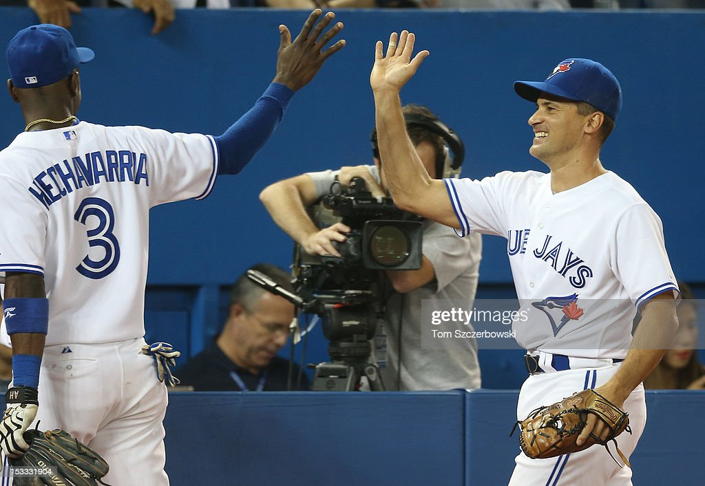 <a gi-track='captionPersonalityLinkClicked' href=/galleries/search?phrase=Omar+Vizquel&family=editorial&specificpeople=201489 ng-click='$event.stopPropagation()'>Omar Vizquel</a> #13 of the Toronto Blue Jays is congratulated by Adeiny Hechavarria #3 after making a defensive play in the seventh inning during MLB game action against the Minnesota Twins on October 3, 2012 at Rogers Centre in Toronto, Ontario, Canada.