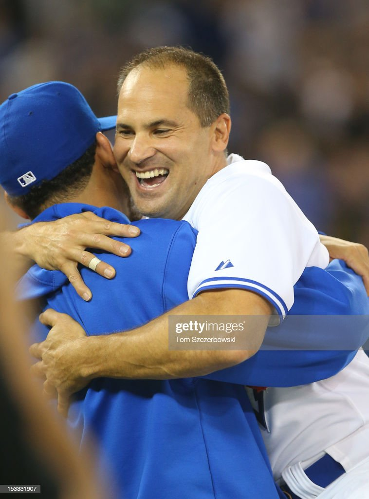 <a gi-track='captionPersonalityLinkClicked' href=/galleries/search?phrase=Omar+Vizquel&family=editorial&specificpeople=201489 ng-click='$event.stopPropagation()'>Omar Vizquel</a> #13 of the Toronto Blue Jays is congratulated by <a gi-track='captionPersonalityLinkClicked' href=/galleries/search?phrase=Henderson+Alvarez&family=editorial&specificpeople=7091625 ng-click='$event.stopPropagation()'>Henderson Alvarez</a> #37 after his last career game in MLB game action against the Minnesota Twins on October 3, 2012 at Rogers Centre in Toronto, Ontario, Canada.