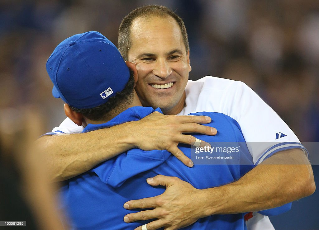 Omar Vizquel #13 of the Toronto Blue Jays is congratulated by Henderson Alvarez #37 after his last career game in MLB game action against the Minnesota Twins on October 3, 2012 at Rogers Centre in Toronto, Ontario, Canada.