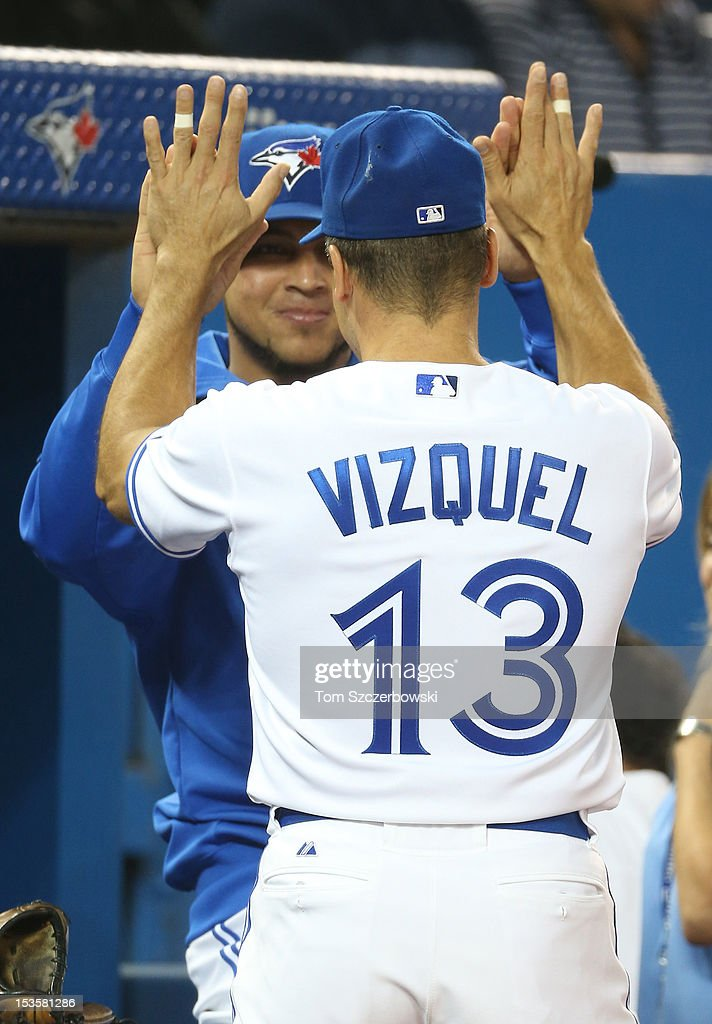 Omar Vizquel #13 of the Toronto Blue Jays is congratulated on his career by fellow Venezuelan Henderson Alvarez #37 before MLB game action against the Minnesota Twins on October 3, 2012 at Rogers Centre in Toronto, Ontario, Canada.