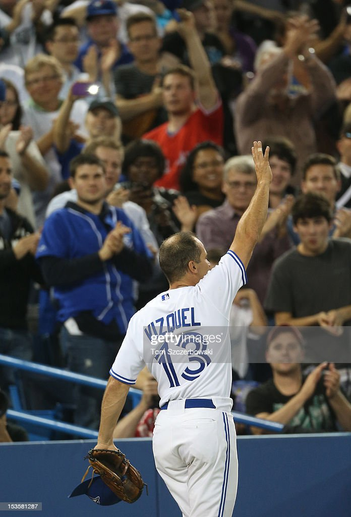 Omar Vizquel #13 of the Toronto Blue Jays salutes fans after leaving the game in the ninth inning in the final game of his career during MLB game action against the Minnesota Twins on October 3, 2012 at Rogers Centre in Toronto, Ontario, Canada.