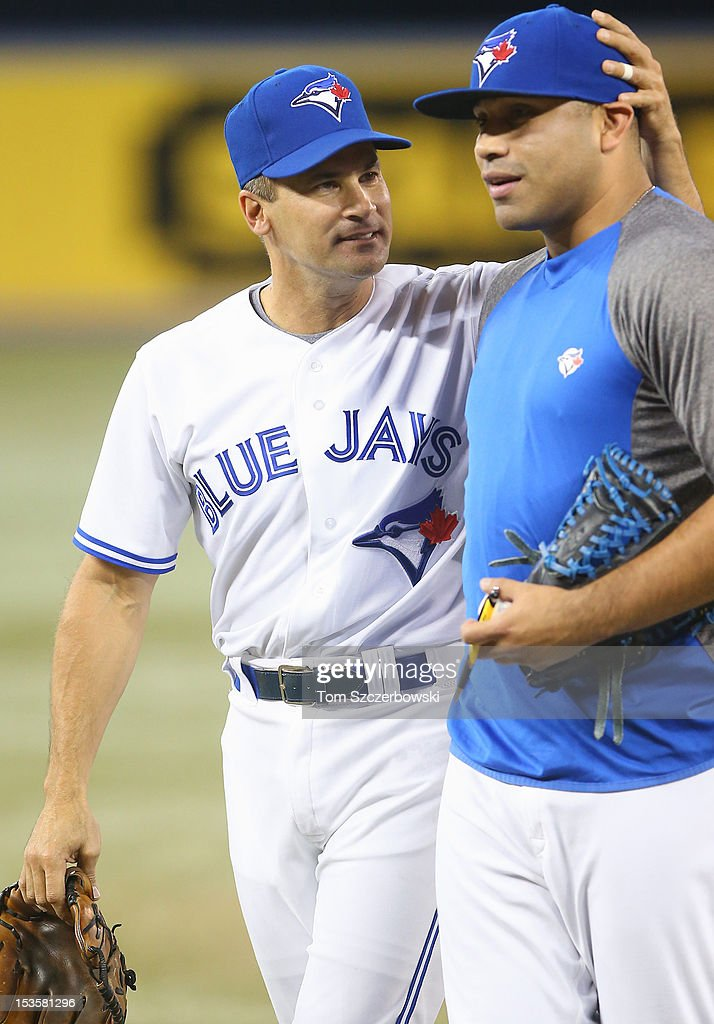 Omar Vizquel #13 of the Toronto Blue Jays thanks Ricky Romero #24 after throwing out the first pitch before his last career game prior to the start of MLB game action against the Minnesota Twins on October 3, 2012 at Rogers Centre in Toronto, Ontario, Canada.