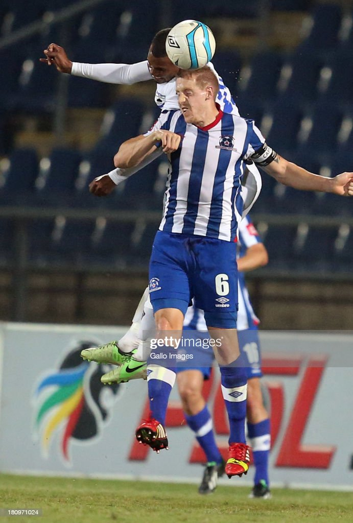 Omar Zane Hendricks of MP Black Aces out jumps Michael Morton Captain of Maritzburg Utd during the Absa Premiership match between Maritzburg United and MP Black Aces at Harry Gwala Stadium on September 18, 2013 in Durban, South Africa.