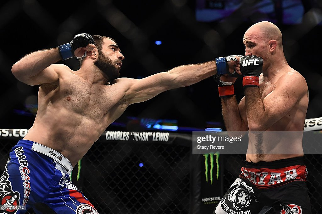 Omari Akhmedov punches Brian Ebersole in their welterweight bout during the UFC Fight Night event at Smoothie King Center on June 6 2015 in New...