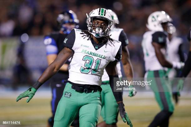 Omari Cobb of the Marshall Thundering Herd reacts after a defensive stop on fourth down in the fourth quarter of a game against the Middle Tennessee...