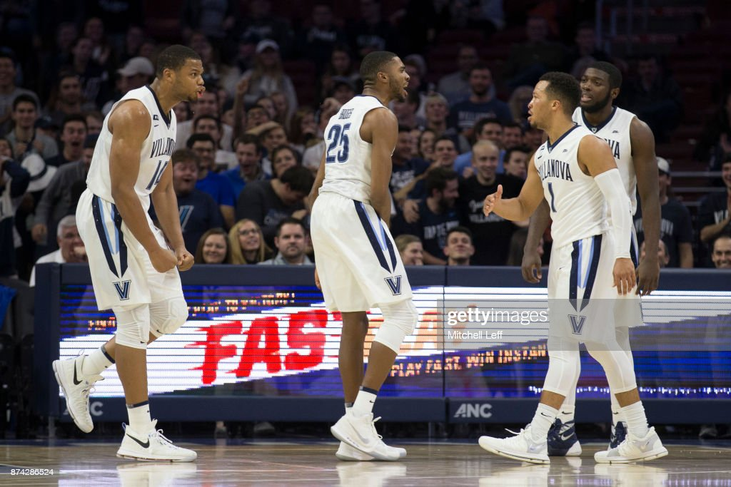 Omari Spellman #14, Mikal Bridges #25, Jalen Brunson #1, and Eric Paschall #4 of the Villanova Wildcats react in the first half against the Nicholls State Colonels at the Wells Fargo Center on November 14, 2017 in Philadelphia, Pennsylvania. The Villanova Wildcats defeated the Nicholls State Colonels 113-77.