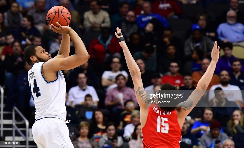 Omari Spellman #14 of the Villanova Wildcats puts up a jump shot over Devonnte Holland #15 of the Radford Highlanders in the second half during the first round of the 2018 NCAA Men's Basketball Tournament held at PPG Paints Arena on March 15, 2018 in Pittsburgh, Pennsylvania.