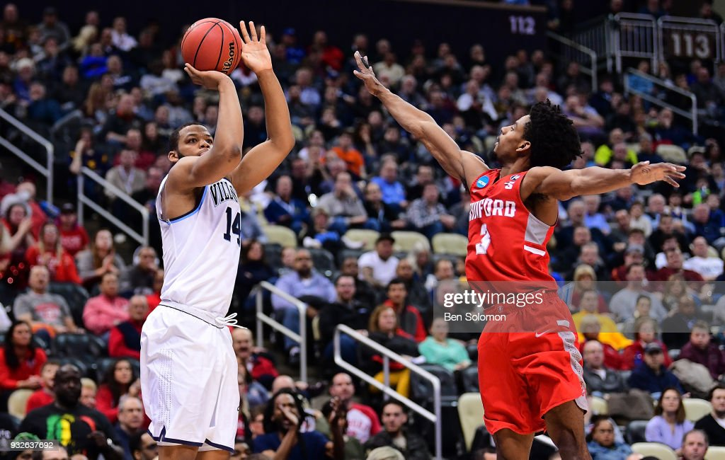 Omari Spellman #14 of the Villanova Wildcats puts up a jump shot over Christian Bradford #3 of the Radford Highlanders in the first half during the first round of the 2018 NCAA Men's Basketball Tournament held at PPG Paints Arena on March 15, 2018 in Pittsburgh, Pennsylvania.