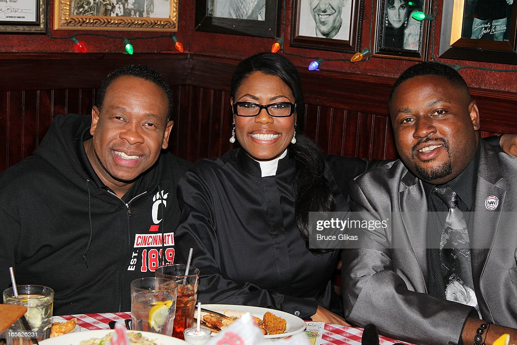 Omarosa Manigault (CTR) and friends visit Buca di Beppo in Times Square on April 5, 2013 in New York City.