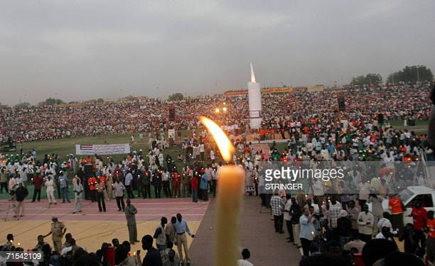 Tens of thousands of Sudanese hold candles in Khartoum's twin city of Omdurman to pay homage to mark the first anniversary of former southern rebel...