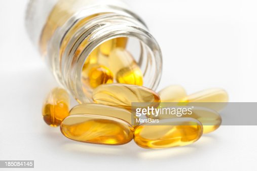 Omega 3 fish oil capsules and bottle