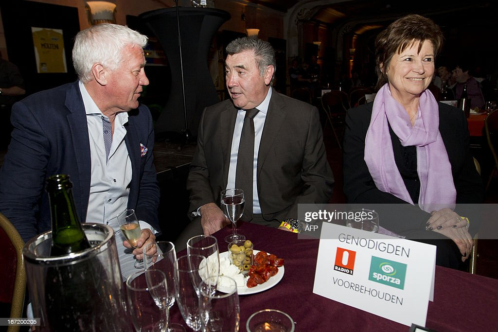 Omega Pharma - Quick-Step Cycling team manager Patrick Lefevere (L) speaks Belgian cycling legend Eddy Merckx and his wife Claudine Acou prior to attend the 'Sporza Merckx' event organized by Radio 1 and Sporza, in honor of Merckx and the 100th Tour de France, on April 22, 2013 at De Roma in Borgerhout in Antwerp.