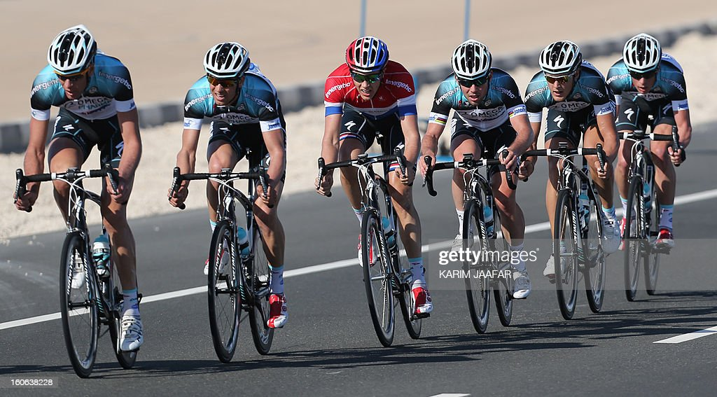Omega Pharma-Quick Step team's leader Mark Cavendish (4thL) rides his bike with teammates during the second stage of the 2013 cycling Tour of Qatar, a 14-kilometre team time-trial, in the Qatari capital Doha, on February 4, 2013. US team BMC won the event in 16min 7.21sec, five seconds ahead of Britain's Team Sky and 10 seconds in front of Omega Pharma.