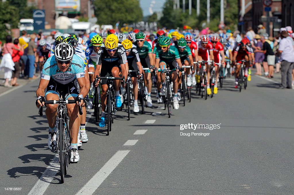 Omega Pharma-Quickstep drives the peloton during stage two of the 2012 Tour de France from Vise to Tournai on July 2, 2012 in Tournai, Belgium.