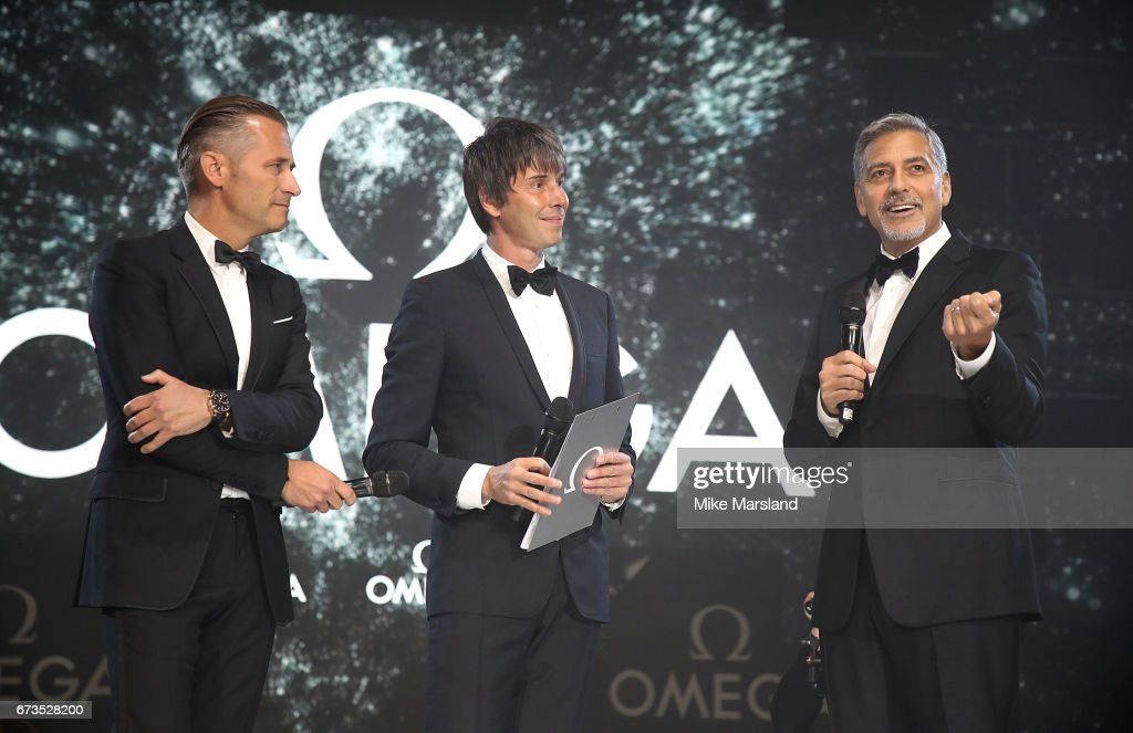 Omega President and CEO Raynald Aeschlimann, Prof. Brian Cox and George Clooney on stage at the OMEGA 'Lost In Space' dinner to celebrate the 60th anniversary of the OMEGA Speedmaster, which has been worn by every piloted NASA mission since 1965, at Tate Modern on April 26, 2017 in London, England.