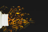 omega3 capsules on black background