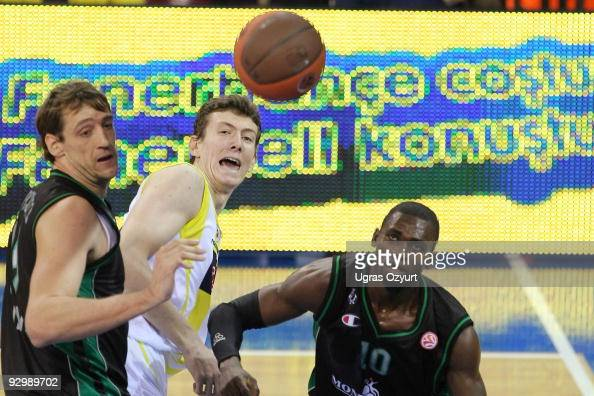 Omer Asik #24 of Fenerbahce Ulker competes with and Romain Sato #10 of Montepaschi Siena competes with and Denis Marconato #18 of Montepaschi Siena...