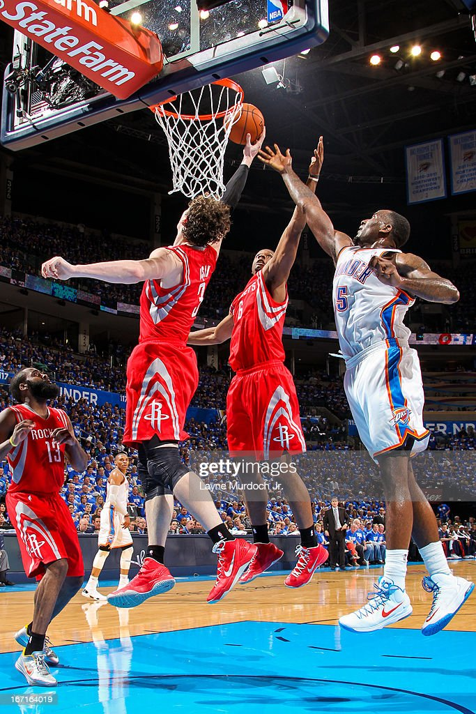 Omer Asik #3 and Terrence Jones #6 of the Houston Rockets reach for a rebound against <a gi-track='captionPersonalityLinkClicked' href=/galleries/search?phrase=Kendrick+Perkins&family=editorial&specificpeople=211461 ng-click='$event.stopPropagation()'>Kendrick Perkins</a> #5 of the Oklahoma City Thunder in Game One of the Western Conference Quarterfinals during the 2013 NBA playoffs on April 21, 2013 at the Chesapeake Energy Arena in Oklahoma City, Oklahoma.