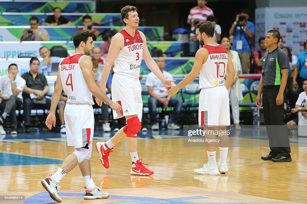 Omer Asik (C), Dogus Balbay (L) and Melih Mahmutoglu of Turkey in action during a friendly match between Philippines and Turkey friendly match at Mall of Asia Arena (MOA) in Pasay, Philippines on July 01, 2016.