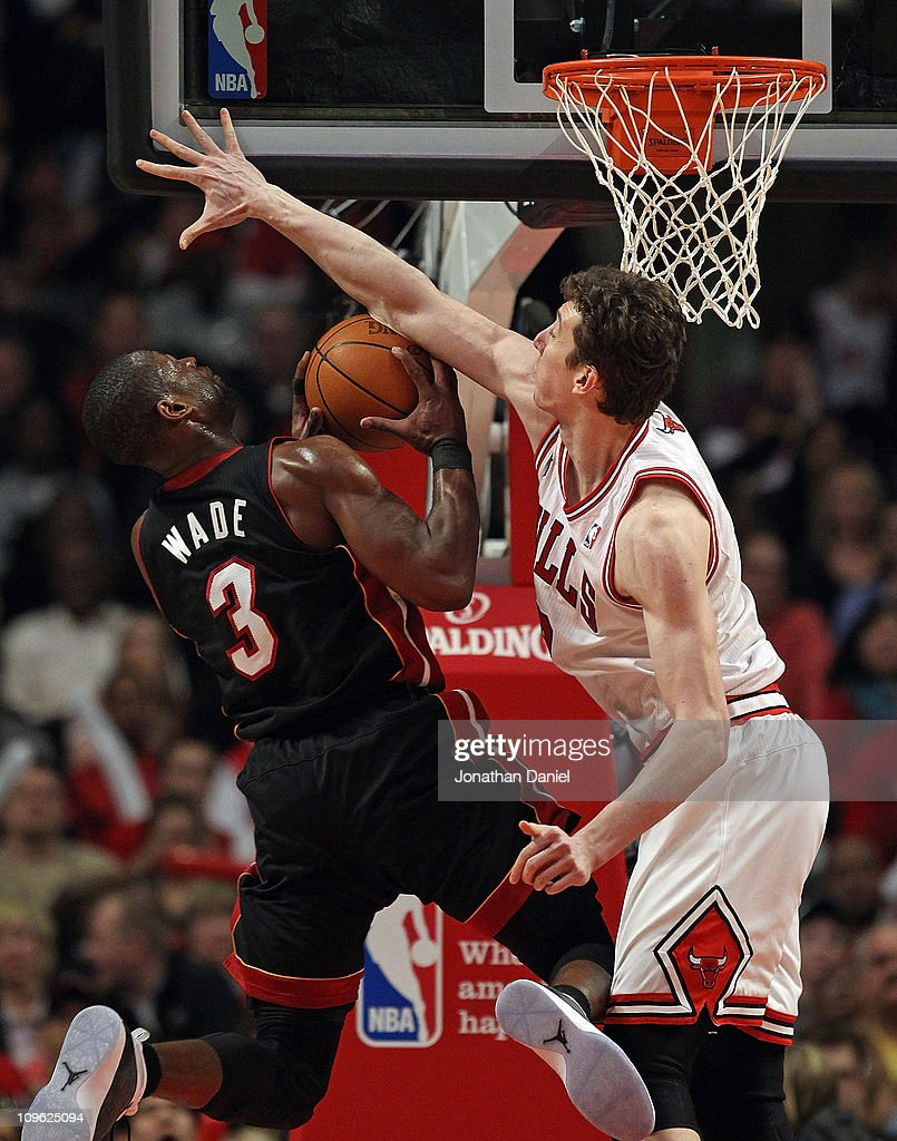 Omer Asik #3 of the Chicago Bulls fouls <a gi-track='captionPersonalityLinkClicked' href=/galleries/search?phrase=Dwyane+Wade&family=editorial&specificpeople=201481 ng-click='$event.stopPropagation()'>Dwyane Wade</a> #3 of the Miami Heat at the United Center on February 24, 2011 in Chicago, Illinois. The Bulls defeated the Heat 93-89.