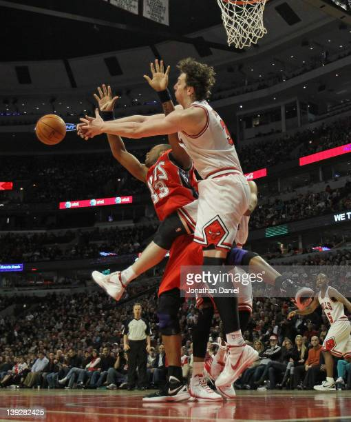 Omer Asik of the Chicago Bulls grabs for a rebound around Shelden Williams of the New Jersey Nets at the United Center on February 18 2012 in Chicago...