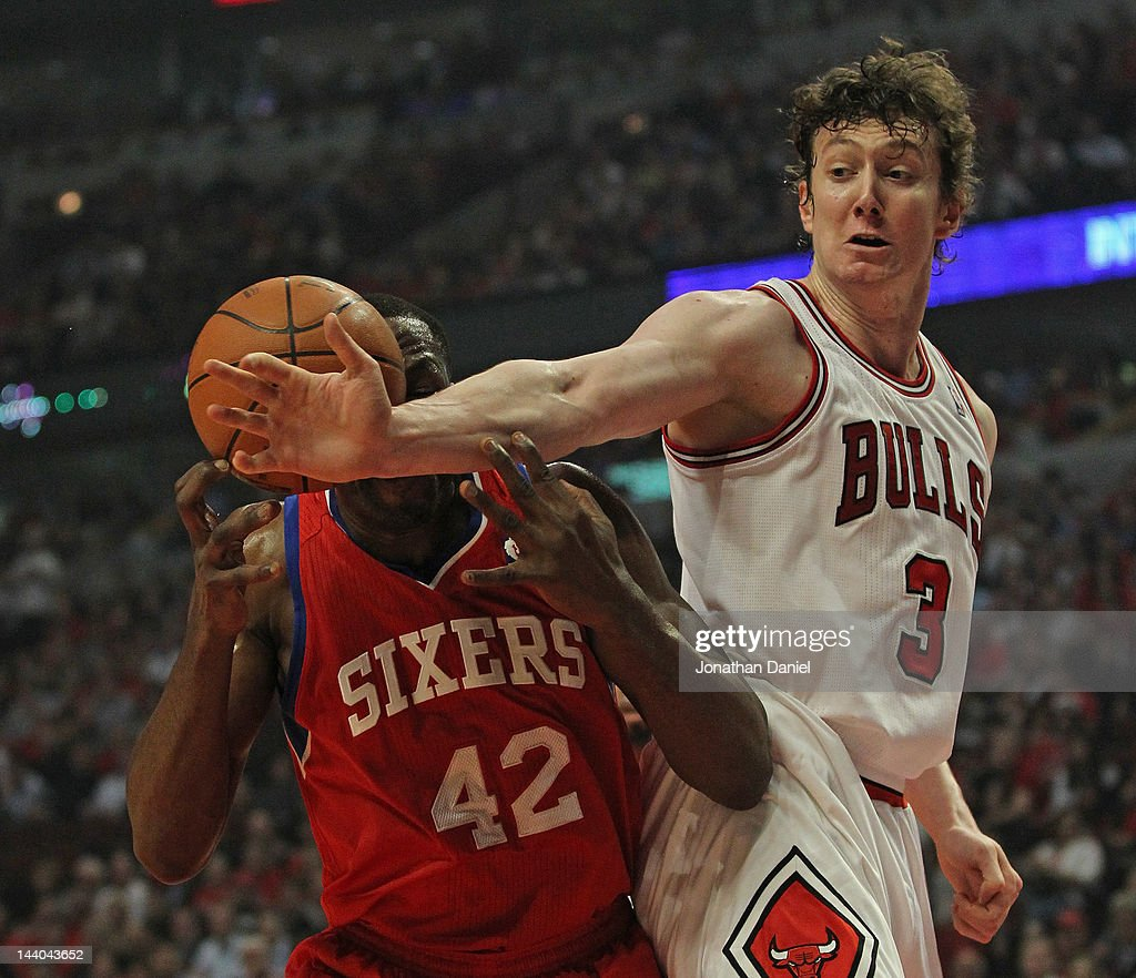<a gi-track='captionPersonalityLinkClicked' href=/galleries/search?phrase=Omer+Asik&family=editorial&specificpeople=4946055 ng-click='$event.stopPropagation()'>Omer Asik</a> #3 of the Chicago Bulls knocks the ball away from <a gi-track='captionPersonalityLinkClicked' href=/galleries/search?phrase=Elton+Brand&family=editorial&specificpeople=201501 ng-click='$event.stopPropagation()'>Elton Brand</a> #42 of the Philadelphia 76ers in Game Five of the Eastern Conference Quarterfinals during the 2012 NBA Playoffs at the United Center on May 8, 2012 in Chicago, Illinois.