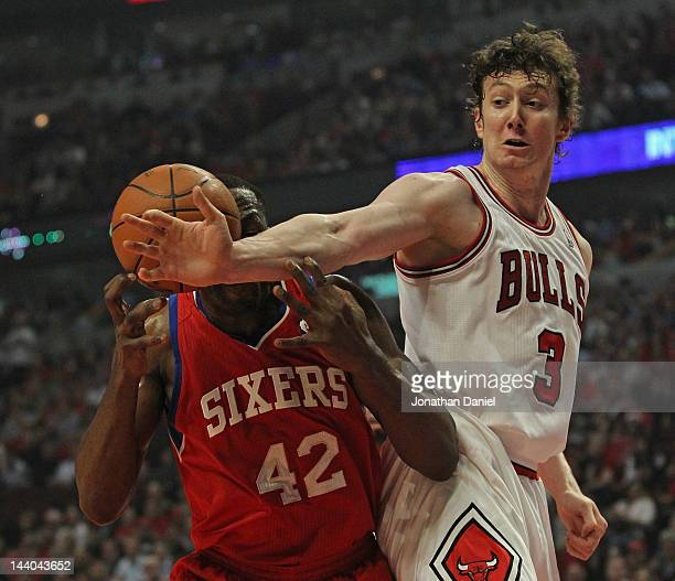 Omer Asik of the Chicago Bulls knocks the ball away from Elton Brand of the Philadelphia 76ers in Game Five of the Eastern Conference Quarterfinals...