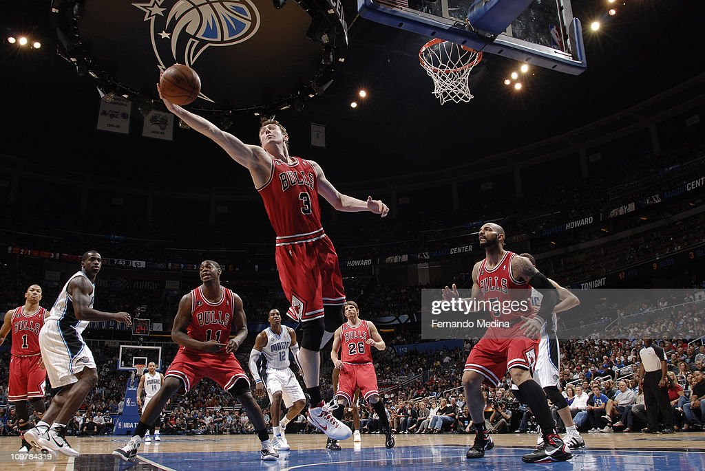 Omer Asik #3 of the Chicago Bulls rebounds against the Orlando Magic on March 4, 2011 at the Amway Center in Orlando, Florida.
