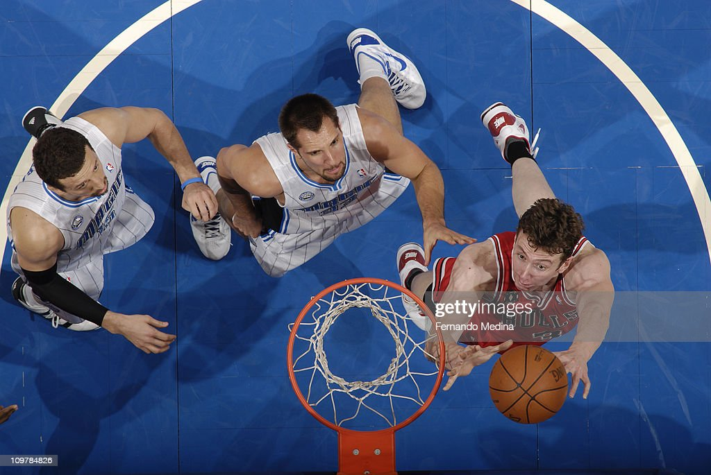 Omer Asik #3 of the Chicago Bulls reboundss over Ryan Anderson #33 and <a gi-track='captionPersonalityLinkClicked' href=/galleries/search?phrase=Hedo+Turkoglu&family=editorial&specificpeople=201639 ng-click='$event.stopPropagation()'>Hedo Turkoglu</a> #15 of the Orlando Magic on March 4, 2011 at the Amway Center in Orlando, Florida.