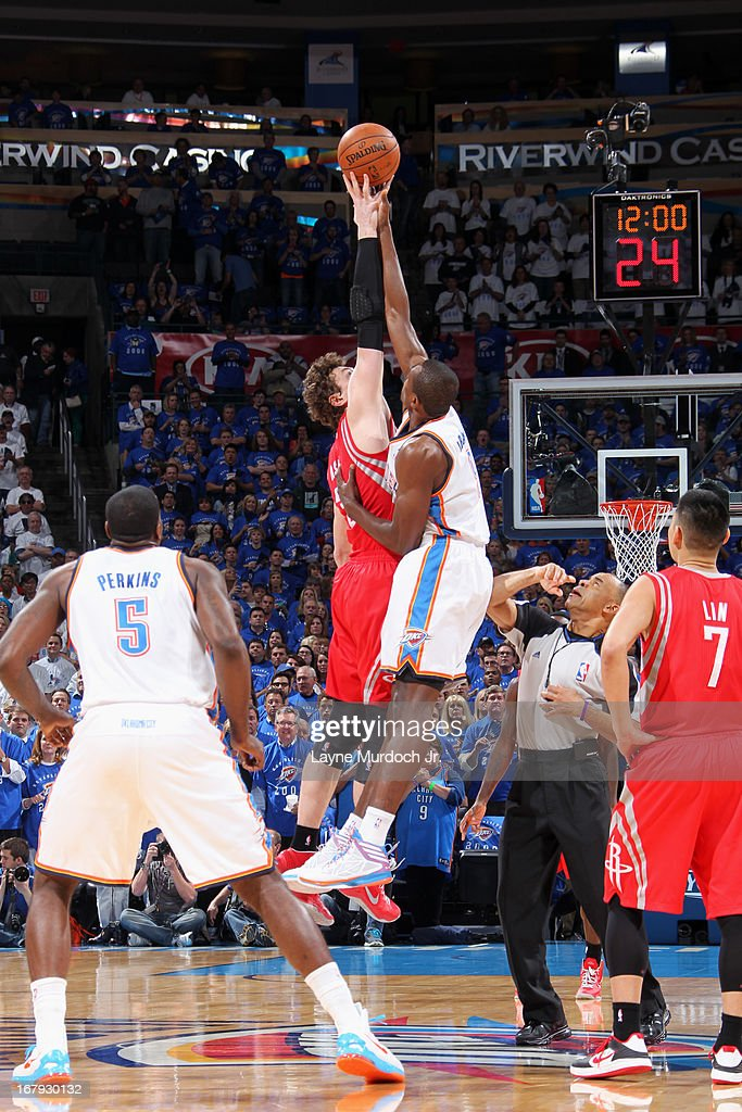 Omer Asik #3 of the Houston Rockets and <a gi-track='captionPersonalityLinkClicked' href=/galleries/search?phrase=Serge+Ibaka&family=editorial&specificpeople=5133378 ng-click='$event.stopPropagation()'>Serge Ibaka</a> #9 of the Oklahoma City Thunder go up for the opening tip off in Game Two of the Western Conference Quarter Finals during the 2013 NBA playoffs on April 24, 2013 at the Chesapeake Energy Arena in Oklahoma City, Oklahoma.