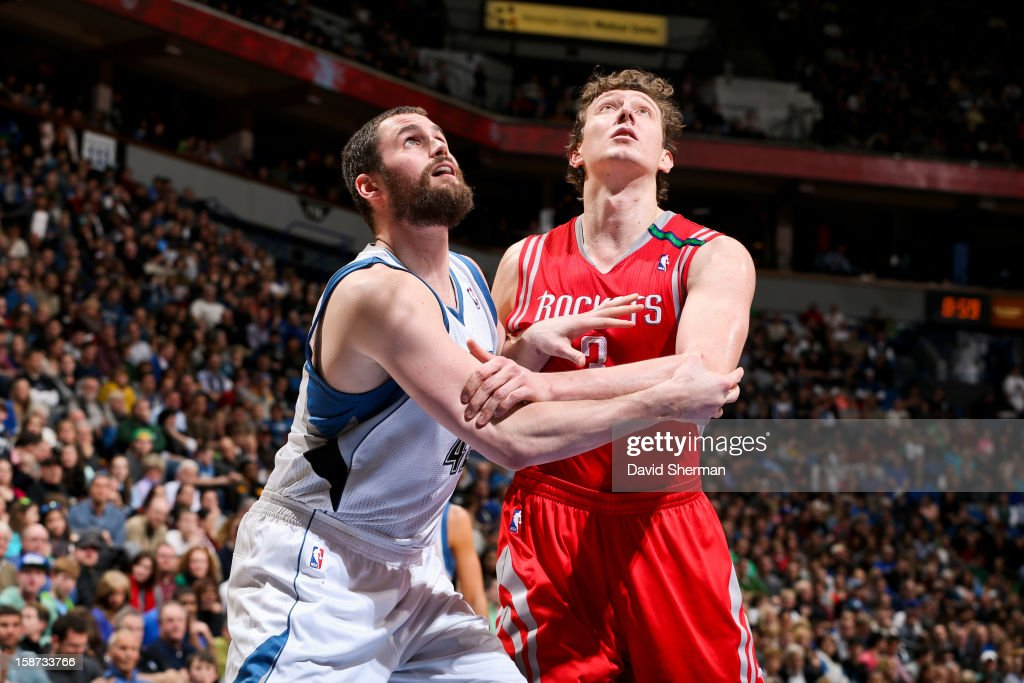Omer Asik #3 of the Houston Rockets battles for rebound position against Kevin Love #42 of the Minnesota Timberwolves on December 26, 2012 at Target Center in Minneapolis, Minnesota.