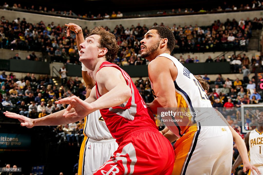 Omer Asik #3 of the Houston Rockets battles for rebound position against Jeff Pendergraph #29 of the Indiana Pacers on January 18, 2013 at Bankers Life Fieldhouse in Indianapolis, Indiana.