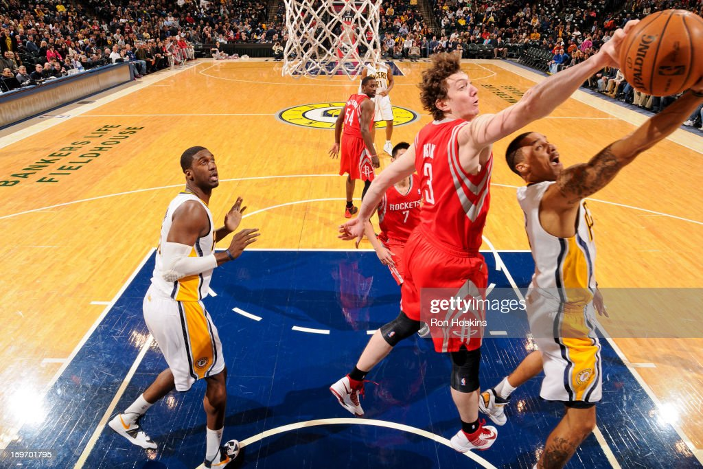 Omer Asik #3 of the Houston Rockets blocks a shot attempt by George Hill #3 of the Indiana Pacers on January 18, 2013 at Bankers Life Fieldhouse in Indianapolis, Indiana.