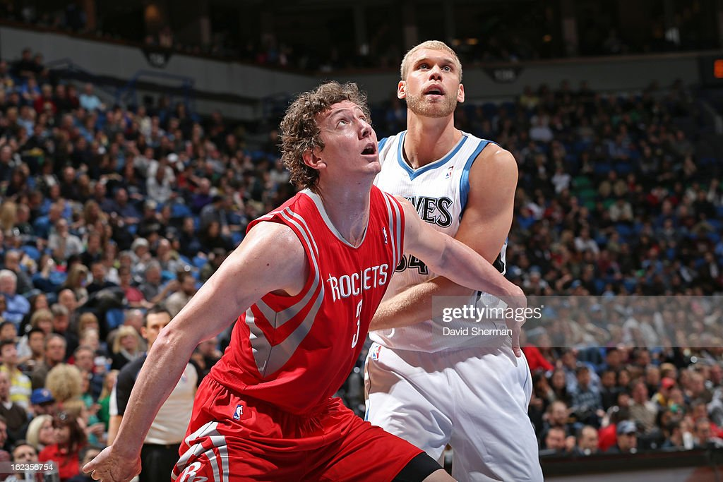 Omer Asik #3 of the Houston Rockets boxes out Greg Stiemsma #34 of the Minnesota Timberwolves on January 19, 2013 at Target Center in Minneapolis, Minnesota.