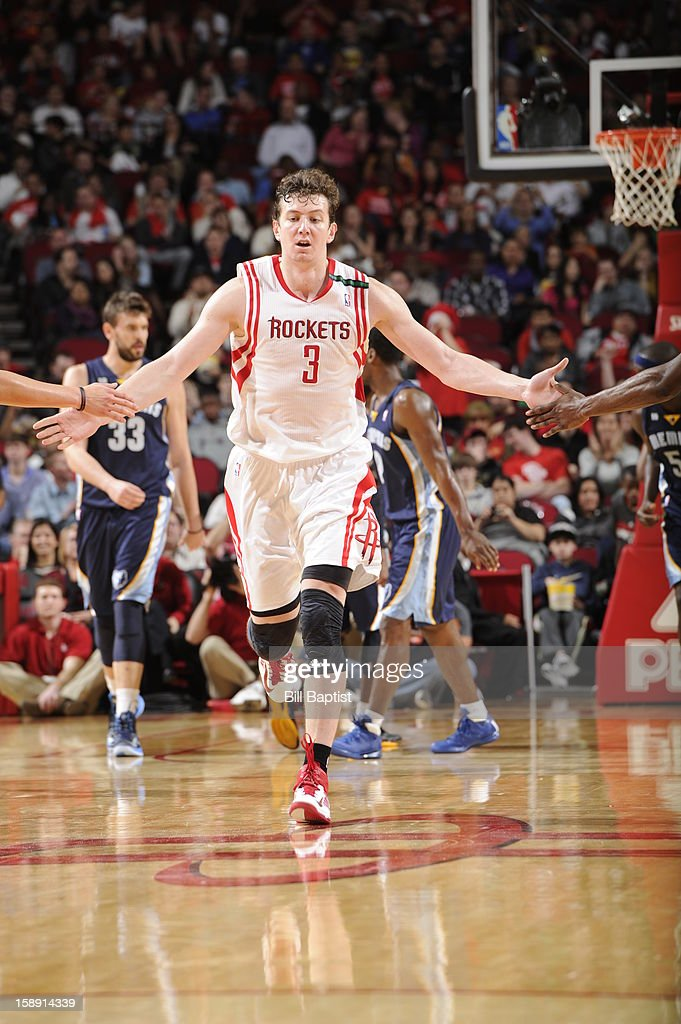 <a gi-track='captionPersonalityLinkClicked' href=/galleries/search?phrase=Omer+Asik&family=editorial&specificpeople=4946055 ng-click='$event.stopPropagation()'>Omer Asik</a> #3 of the Houston Rockets celebrates a shot as he runs up court against the Memphis Grizzlies on December 22, 2012 at the Toyota Center in Houston, Texas.