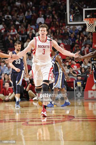 Omer Asik of the Houston Rockets celebrates a shot as he runs up court against the Memphis Grizzlies on December 22 2012 at the Toyota Center in...
