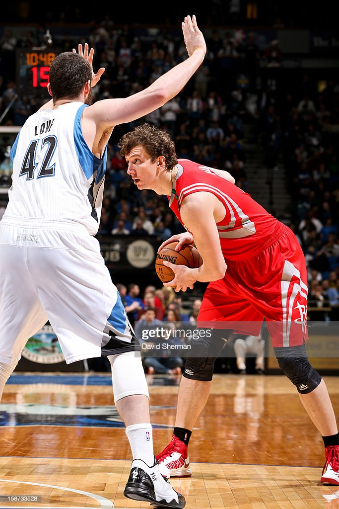 Omer Asik #3 of the Houston Rockets controls the ball against Kevin Love #42 of the Minnesota Timberwolves on December 26, 2012 at Target Center in Minneapolis, Minnesota.