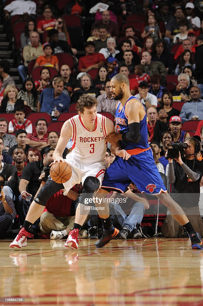 Omer Asik #3 of the Houston Rockets drives the ball against <a gi-track='captionPersonalityLinkClicked' href=/galleries/search?phrase=Tyson+Chandler&family=editorial&specificpeople=202061 ng-click='$event.stopPropagation()'>Tyson Chandler</a> #6 of the New York Knicks on November 23, 2012 at the Toyota Center in Houston, Texas.