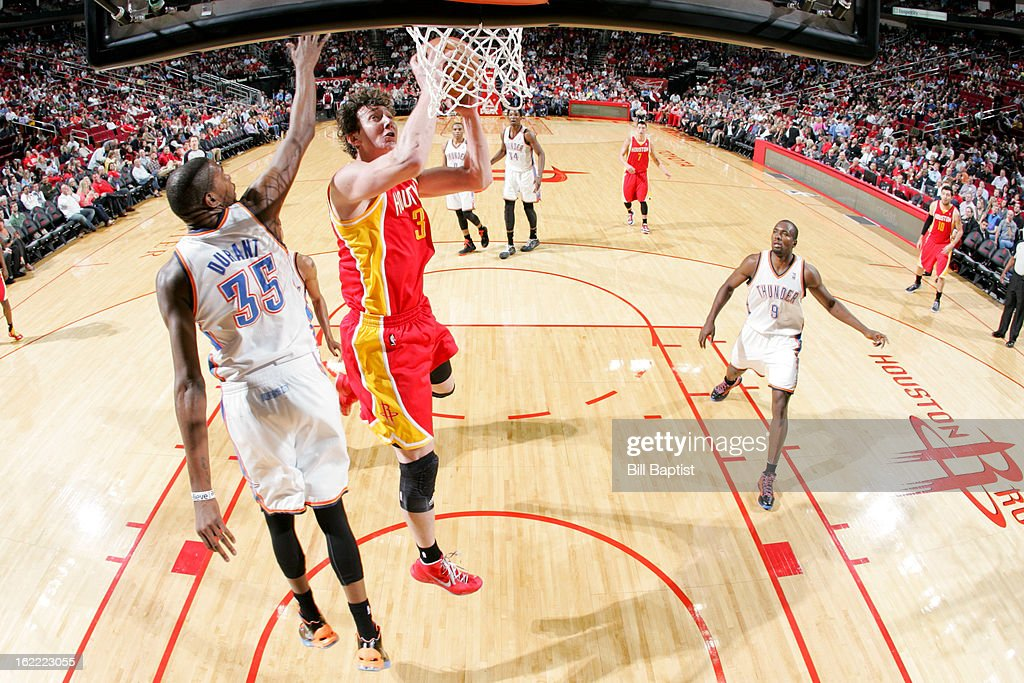 <a gi-track='captionPersonalityLinkClicked' href=/galleries/search?phrase=Omer+Asik&family=editorial&specificpeople=4946055 ng-click='$event.stopPropagation()'>Omer Asik</a> #3 of the Houston Rockets drives to the basket against <a gi-track='captionPersonalityLinkClicked' href=/galleries/search?phrase=Kevin+Durant&family=editorial&specificpeople=3847329 ng-click='$event.stopPropagation()'>Kevin Durant</a> #35 of the Oklahoma City Thunder on February 20, 2013 at the Toyota Center in Houston, Texas.