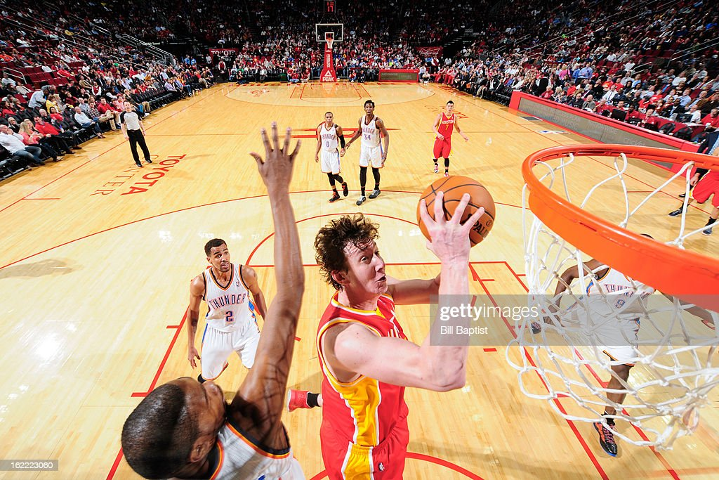 Omer Asik #3 of the Houston Rockets drives to the basket against <a gi-track='captionPersonalityLinkClicked' href=/galleries/search?phrase=Kevin+Durant&family=editorial&specificpeople=3847329 ng-click='$event.stopPropagation()'>Kevin Durant</a> #35 of the Oklahoma City Thunder on February 20, 2013 at the Toyota Center in Houston, Texas.