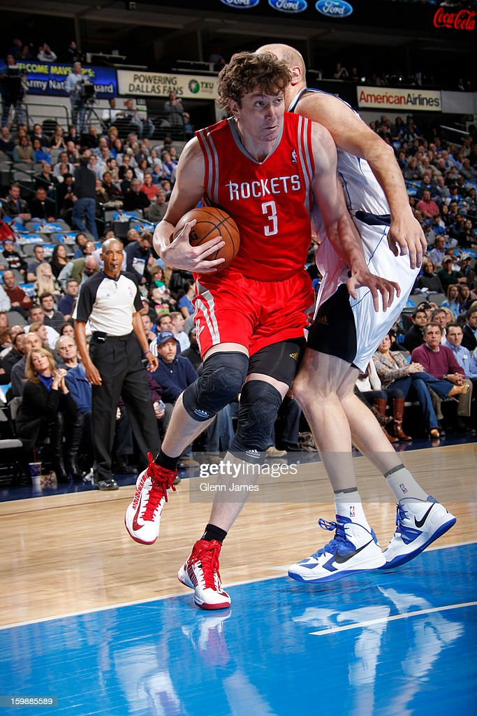 Omer Asik #3 of the Houston Rockets drives to the basket against the Dallas Mavericks on January 16, 2013 at the American Airlines Center in Dallas, Texas.