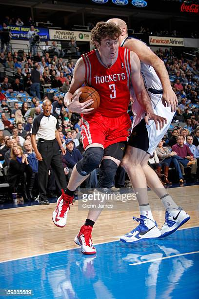 Omer Asik of the Houston Rockets drives to the basket against the Dallas Mavericks on January 16 2013 at the American Airlines Center in Dallas Texas...