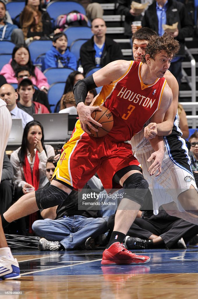 Omer Asik #3 of the Houston Rockets drives to the basket against the Orlando Magic during the game on March 1, 2013 at Amway Center in Orlando, Florida.