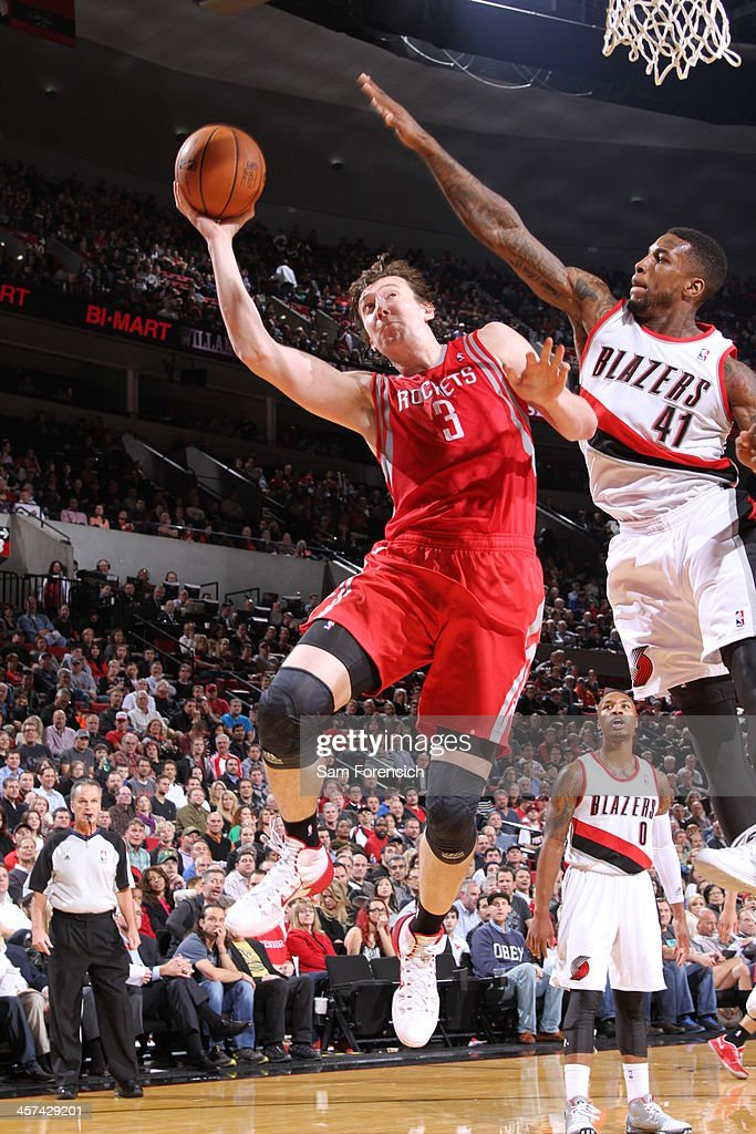 <a gi-track='captionPersonalityLinkClicked' href=/galleries/search?phrase=Omer+Asik&family=editorial&specificpeople=4946055 ng-click='$event.stopPropagation()'>Omer Asik</a> #3 of the Houston Rockets drives to the basket against the Portland Trail Blazers on November 5, 2013 at the Moda Center Arena in Portland, Oregon.