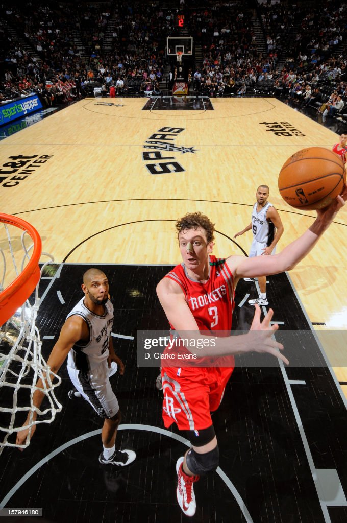 <a gi-track='captionPersonalityLinkClicked' href=/galleries/search?phrase=Omer+Asik&family=editorial&specificpeople=4946055 ng-click='$event.stopPropagation()'>Omer Asik</a> #3 of the Houston Rockets drives to the basket against the San Antonio Spurs on December 7, 2012 at the AT&T Center in San Antonio, Texas.